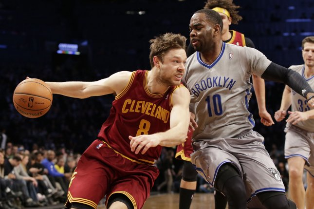 Ex-Brooklyn Nets guard Marcus Thornton defends Cleveland Cavaliers guard Matthew Dellavedova (8) who drives to the basket in the first half on March 28, 2014 at Barclays Center in New York City. File photo by John Angelillo/UPI