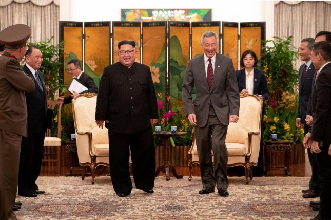 Prime Minister Lee Hsien Loong (R) of Singapore meets with North Korean leader Kim Jong Un in June. Despite Singapore's all-out $15 million effort to host U.S. President Donald Trump and Kim for their first summit, the city-state is on the more cautious end of the spectrum when it comes to a new South Korean policy. File Photo by Terence Tan/Ministry of Communications and Information, Singapore
