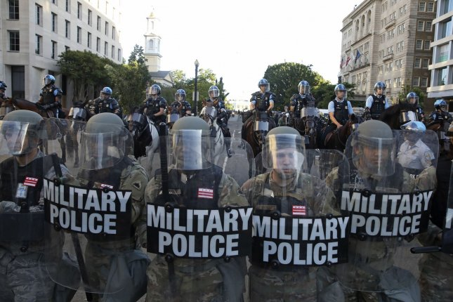 Military police help clear a street near the White House in Washington, D.C., during a demonstration Monday to protest the Minnesota police killing of George Floyd. Photo by Tasos Katopodis/UPI