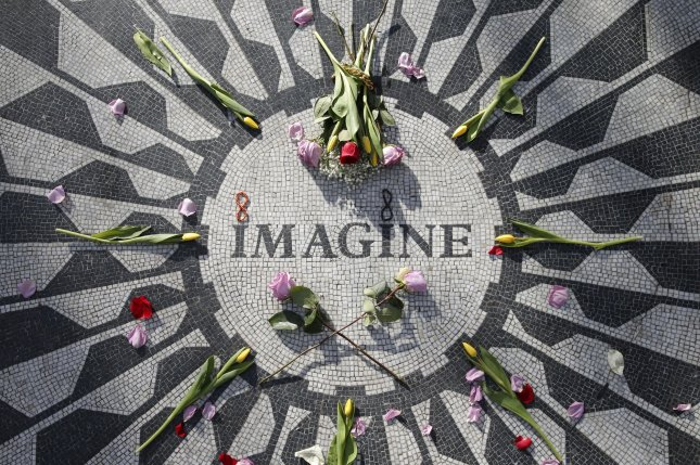 Flowers and petals decorate the Imagine mosaic at Strawberry Fields in New York City's Central Park on Monday, which is dedicated to late Beatle John Lennon on the eve of the 40th anniversary of his assassination on December 8, 1980. Photo by John Angelillo/UPI