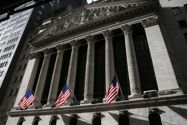 The Dow Jones Industrial Average and S&P 500 rose to record highs on Wednesday despite supporters of President Donald Trump breaching the Capitol building in opposition to the results of the presidential election. Photo by John Angelillo/UPI