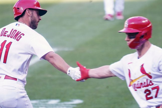 St. Louis Cardinals shortstop Paul DeJong (L) is congratulated by Tyler O'Neill (R) at home plate after hitting a two-run homer against the New York Mets on Wednesday at Busch Stadium in St. Louis, Mo. Photo by Bill Greenblatt/UPI