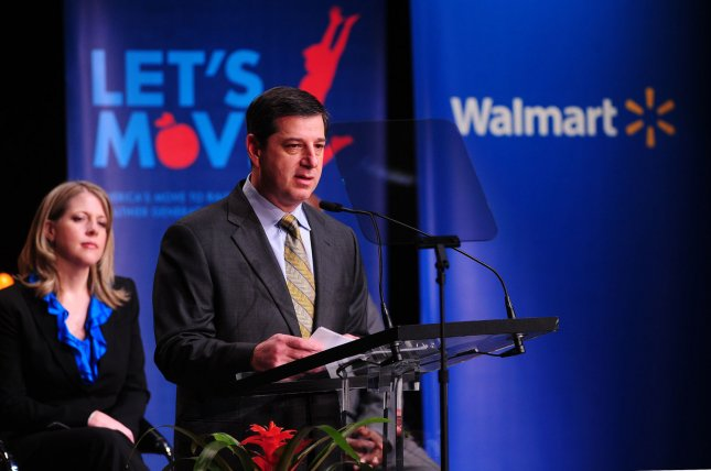 Walmart CEO Bill Simon speaks alongside Andrea Thomas, Senior Vice President of Private Brands, as he announces Walmat's new health initiative in Washington on January 20, 2011. Walmart has announced they will cut the fat, sugar and sodium in some packaged foods and will lower the price of fresh fruits and vegetables. UPI/Kevin Dietsch