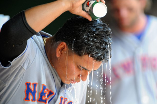 New York Mets shortstop Ruben Tejada (11) pours water on his head prior to the start of the game at Nationals Park in Washington, D.C. on July 22, 2015. Photo by Mark Goldman/UPI