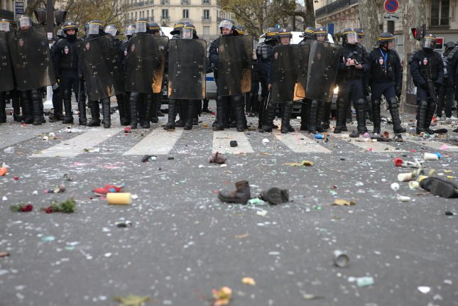 Anti-riot police keep vigil Sunday at a street corner as violence erupted after activists defied a ban on gatherings enforced by French authorities at Republic Square in Paris. More than 100 people were arrested as they attempted to go through with a global march for the climate, on the eve of the opening of COP21 in the French capital. Photo by Maya Vidon-White/UPI