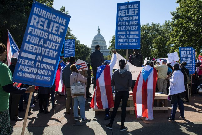 Demonstrators call on Congress and the White House for a recovery and aid package to help after the impact of Hurricane Maria, on October 18, 2017. File Photo by Kevin Dietsch/UPI