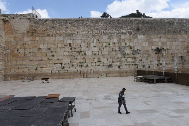 An Israeli border police leaves the Western Wall in the Old City of Jerusalem last month. On Saturday, Jerusalem police closed the gates to the Old City amid fear of protests after a special needs student was fatally shot. File Photo by Debbie Hill/UPI