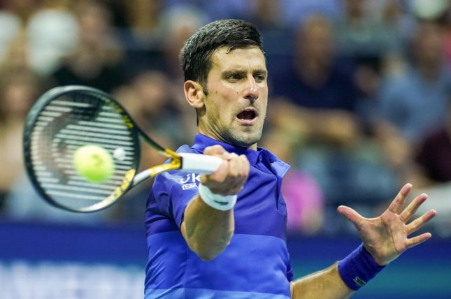 Novak Djokovic of Serbia hits a forehand to Holger Rune of Denmark in the first set of their first-round match inside Arthur Ashe Stadium at the 2021 U.S. Open Tennis Championships on Tuesday at the USTA Billie Jean King National Tennis Center in New York City. Photo by Monika Graff/UPI