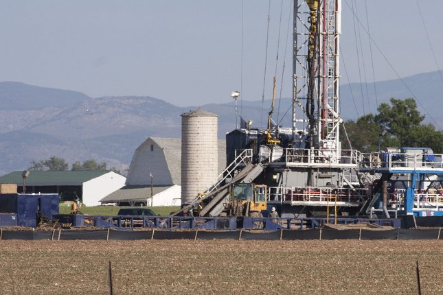 A fracking drilling site operates in close proximity to a farm at the Niobrara oil shale formation in Weld County, North eastern Colorado on May 30, 2012. Gas and oil companies are using hazardous fluid to obtain shale oil and gas in a process called hydraulic fracturing or fracking. A jury in Dallas Texas awarded a family nearly $3 million in damages today for illness caused by nearby fracking operations. UPI/Gary C. Caskey