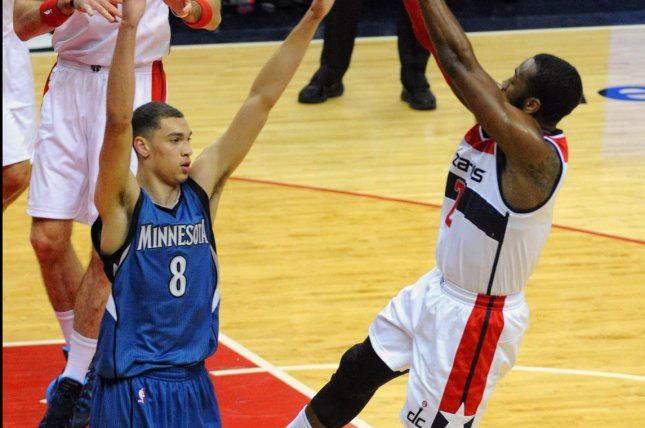 Washington Wizards guard John Wall (2) scores and is fouled by Minnesota Timberwolves guard Zach LaVine (8). UPI/Mark Goldman