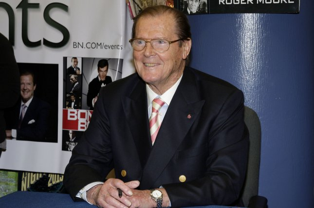 Roger Moore signs copies of the book Bond on Bond in New York on November 9, 2012. The actor died Tuesday after a short battle with cancer. File Photo by John Angelillo/UPI