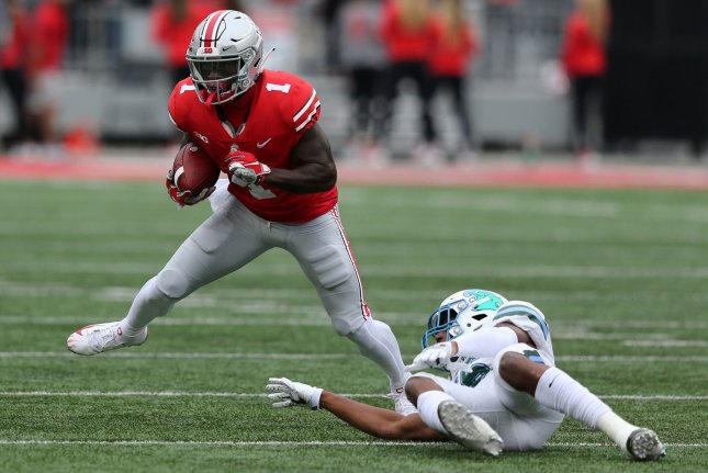 Ohio State's Johnnie Dixon III runs out of the grasp of Tulane's Thakarius Keys in the first half on September 22 in Columbus, Ohio. Photo by Aaron Josefczyk/UPI