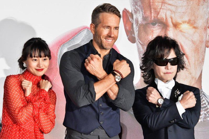 Ryan Reynolds (C), pictured with Shioli Kutsuna (L) and Toshi, stars in a new campaign for Giorgio Armani's cologne Armani Code Absolu. File Photo by Keizo Mori/UPI
