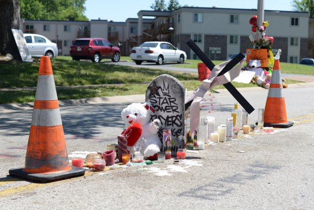 A makeshift memorial sits in the middle of the street in Ferguson, Mo., in honor of Michael Brown on August 9, 2014. After reopening the investigation into Brown's death, the St. Louis County prosecutor declined to charge former officer Darren Wilson. File Photo by David Broome/UPI