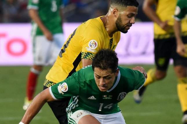 Mexico's Chicharito, front, and Jamaica midfielder Joel McAnuff battle for the ball in the first half of a 2016 Copa America Centenario Group A match at the Rose Bowl in Pasadena, California, on June 9, 2016. Photo by Michael Owen Baker/UPI