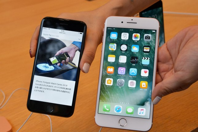 Apple says older iPhones slowed due to battery issues - UPI com