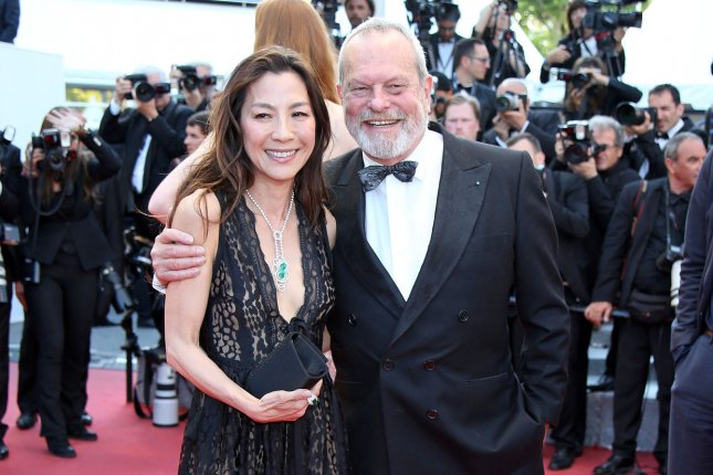 Terry Gilliam (R) with Michelle Yeoh (L). Gilliam's first trailer for his film The Man Who Killed Don Quixote has been released and stars Jonathan Pryce and Adam Driver. File Photo by David Silpa/UPI