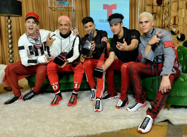 From left to right, Christopher Velez, Richard Camacho, Erick Brian Colon, Joel Pimentel and Zabdiel de Jesus of CNCO appear backstage with their awards for Favorite Pop Artist, Favorite Duo or Group and Favorite Pop Album at the Latin American Music Awards on Thursday. Photo by Jim Ruymen/UPI