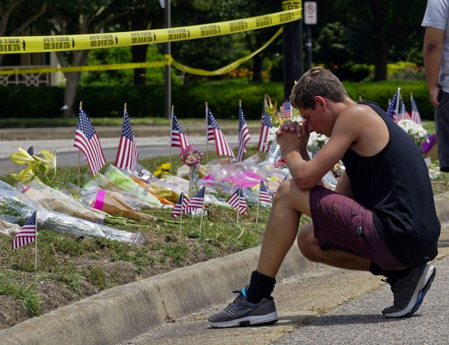 A mourner prays before a makeshift memorial on June 2, 2019, outside the government building where a disgruntled employee killed 12 people on May 31, 2019, in Virginia Beach, Virginia. Photo by Ray Stubblebine/UPI
