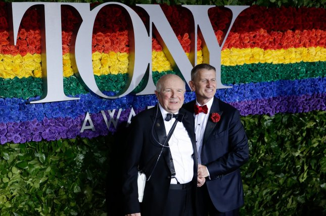 Terrence McNally (left) is survived by his husband, Tom Kirdahy. File Photo by John Angelillo/UPI