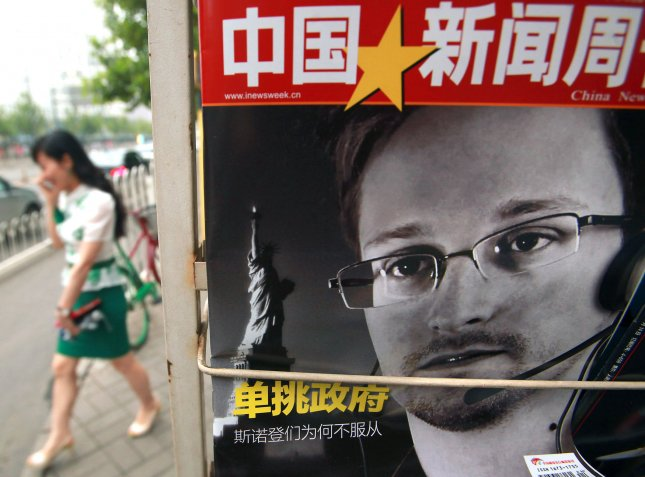 China's version of Newsweek magazine featuring a front-page story on American intelligence leaker Edward Snowden is sold at a news stand in Beijing on July 8, 2013. The White House issued a blistering criticism of China over its decision to let Snowden leave Hong Kong recently, saying by doing so it has hurt U.S.-Sino relations. UPI/Stephen Shaver