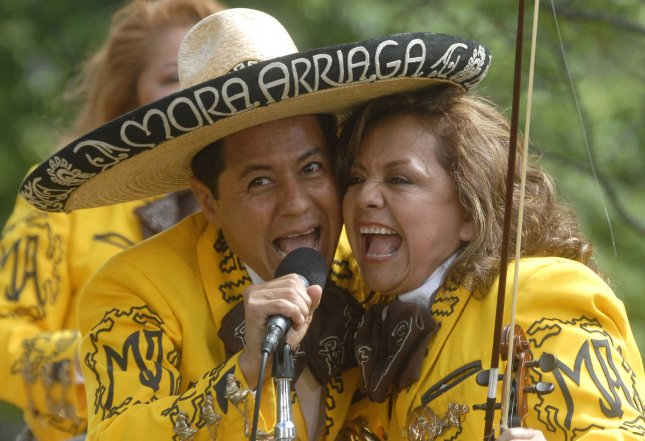 Members of the Los Hermanos Mora Arriaga band perform at a Cinco de Mayo celebration in the Rose Garden at The White House in Washington on May 4, 2007. (UPI Photo/Kevin Dietsch)