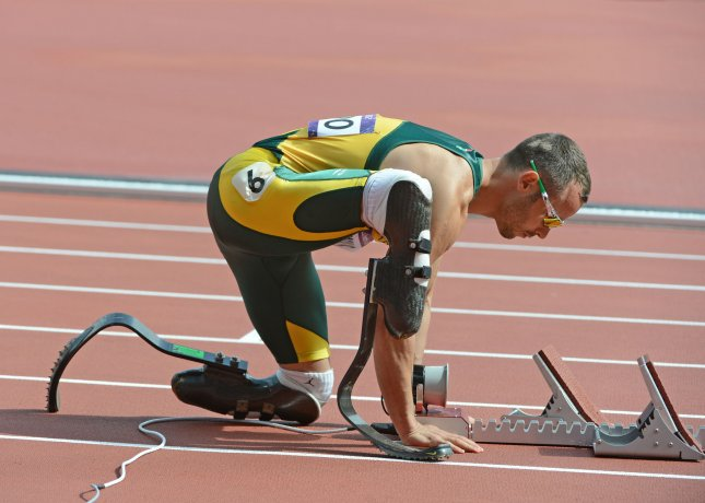 Oscar Pistorius of South Africa adjusts the starting block for the first heat of the Men's 400M in the Track and Field competition at the Olympic Stadium in the London 2012 Summer Olympics on August 4, 2012 in London. UPI/Terry Schmitt