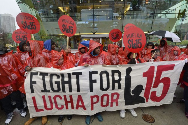 Fast food workers and community activists call for a $15 per hour wage during a demonstration outside of McDonald's flagship restaurant on May 15, 2014 in Chicago. UPI/Brian Kersey