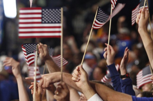 Delegates and guests wave American flags at the Democratic National Convention in Charlotte, N.C., Sept. 4, 2012. UPI/Nell Redmond
