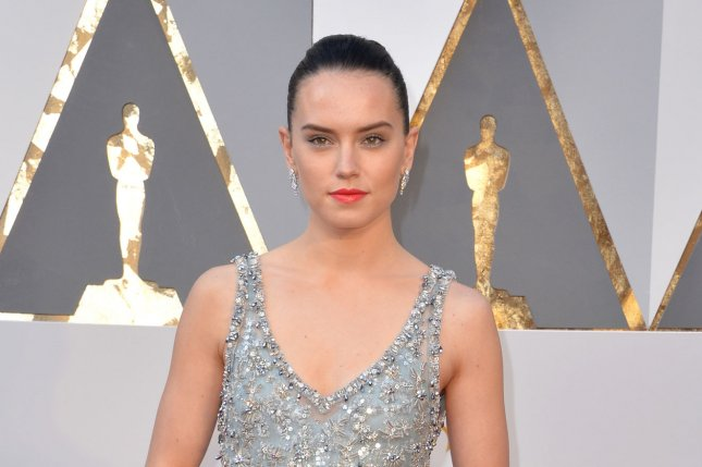 Daisy Ridley arrives on the red carpet for the 88th Academy Awards on February 28, 2016. The Star Wars: The Force Awakens actress thanked donors on behalf of the franchise's Force For Change initiative in honor of Star Wars Day on May 4, 2016. File Photo by Kevin Dietsch/UPI