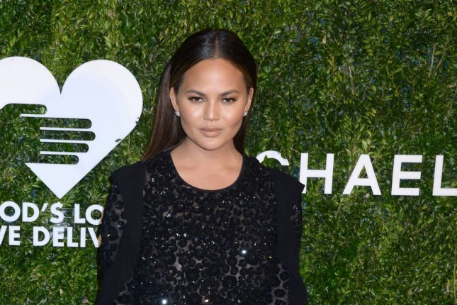 Chrissy Teigen arrives on the red carpet at the God's Love We Deliver Golden Heart Awards on October 17, 2016 in New York City. Teigen fired back at one of her Twitter followers who recently suggested she was holding her 6-month-old daughter incorrectly. File Photo by Dennis Van Tine/UPI
