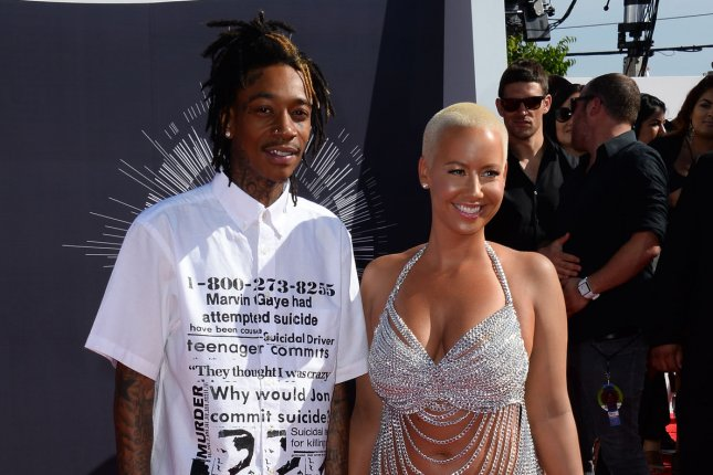Amber Rose (R) and Wiz Khalifa at the MTV Video Music Awards on August 24, 2014. File Photo by Jim Ruymen/UPI