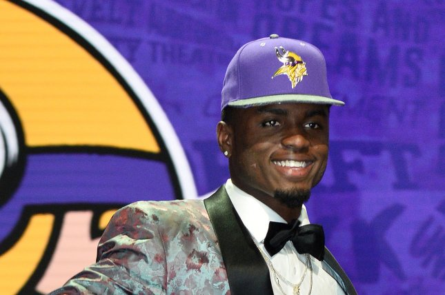 Minnesota Vikings wide receiver Laquon Treadwell walks onto the stage after being selected by the Vikings with the No. 23 overall pick in the 2016 NFL Draft on April 28, 2016 in Chicago. File photo by Brian Kersey/UPI