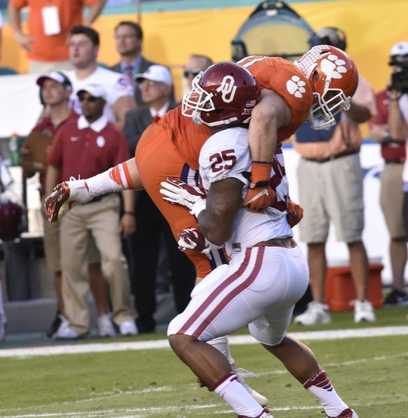 Joe Mixon, throwing a block, was drafted by the Cincinnati Bengals out of Oklahoma. Photo by Gary I Rothstein/UPI
