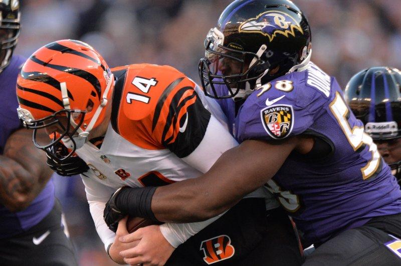 Cincinnati Bengals quarterback Andy Dalton is sacked by former Baltimore Ravens Elvis Dumervil. File photo by Kevin Dietsch/UPI