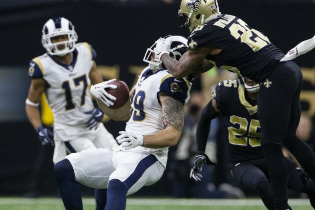 40bc9f92d6 New Orleans Saints cornerback P.J. Williams (26) tackles Los Angeles Rams  tight end Tyler Higbee (89) in the second half of the NFC Championship on  Sunday ...