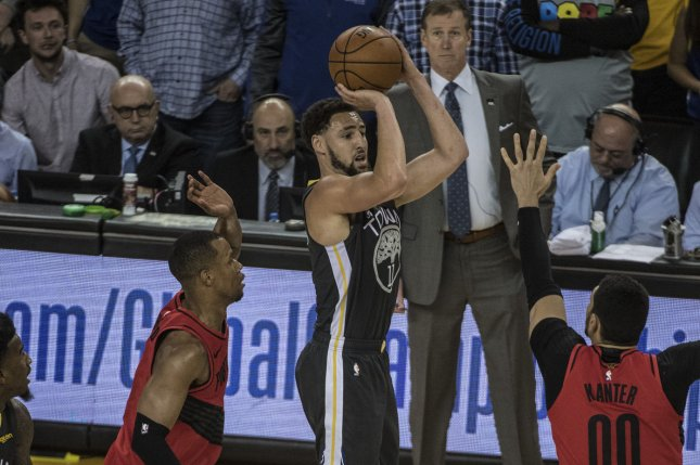 Golden State Warriors guard Klay Thompson (11) had an MRI on Monday that revealed a strained hamstring. He exited the fourth quarter of Game 2 with left hamstring tightness. Photo by Terry Schmitt/UPI