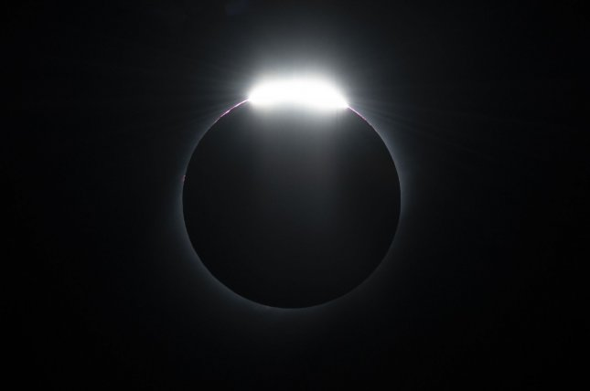 Scientists used observations captured during more than a dozen solar eclipses to study the magnetic field in the sun's corona. Photo by Joe Marino/UPI