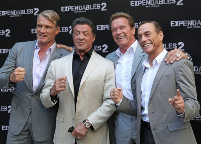 (From L to R) Dolph Lundgren, Sylvester Stallone, Arnold Schwarzenegger and Jean-Claude Van Damme arrive for the French premiere of the film The Expendables 2 in Paris on August 10, 2012. UPI/David Silpa.