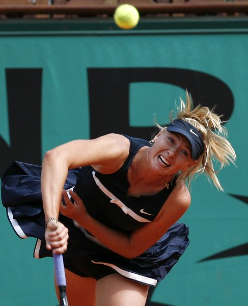 Russian Maria Sharapova hits a serve during her match with Russian Evgeniya Rodina at the French Tennis Open in Paris May 28, 2008. Sharapova survived a first-round scare with a 6-1, 3-6, 8-6 victory. (UPI Photo/ David Silpa)