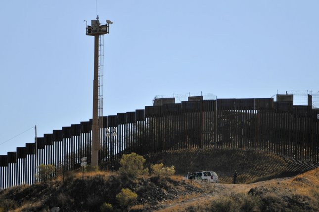 A United States Border Patrol truck sits near the fence along the border between the United States and Mexico in Nogalas, Arizona, December 15, 2011. Also in the photo is one of the electronic surveillance tower to the left. File photo by Art Foxall/UPI