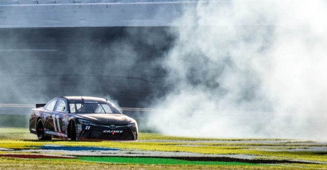 Denny Hamlin, who defends the 135th Sprint Cup race at Martinsville Speedway on Sunday, does a donut in the grass after winning the Daytona 500 at Daytona International Speedway on Feb. 21 in Daytona, Fla. File photo by Edwin Locke/UPI