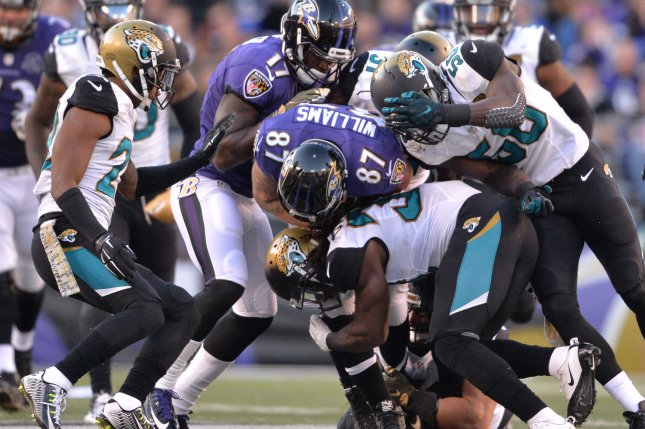 The Jacksonville Jaguars' defensive line swarms for a tackle against the Baltimore Ravens on Nov. 15, 2015 at M&T Bank Stadium. File photo by Kevin Dietsch/UPI