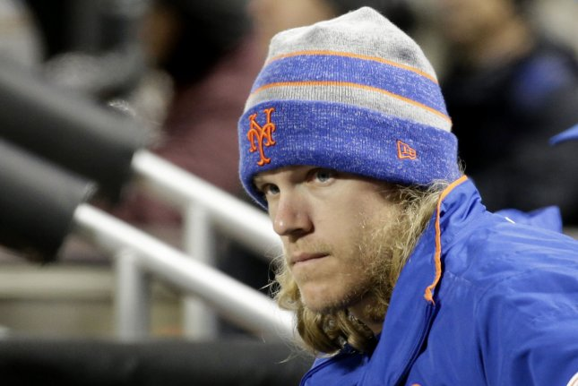 New York Mets pitcher Noah Syndergaard watches the game in the dug out in the eighth inning against the Washington Nationals April 17 at Citi Field in New York City. Photo by John Angelillo/UPI
