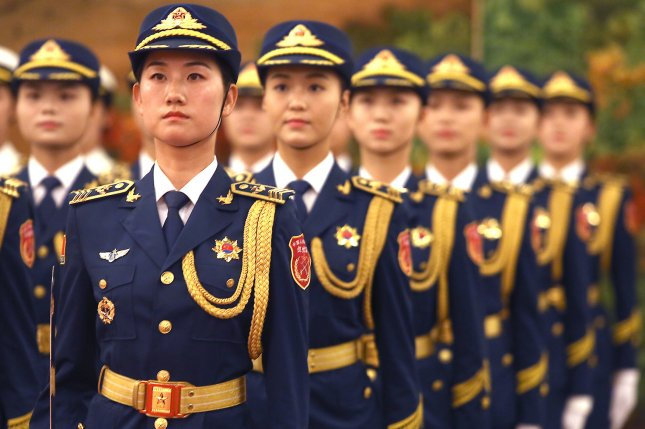 Peoples' Liberation Army (PLA) soldiers arrive to perform honor guard duties for a visiting head of state in Beijing on July 9, 2018. File Photo by Stephen Shaver/UPI