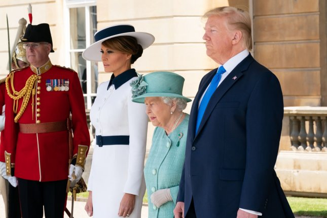 U.S. President Donald Trump (R), first lady Melania Trump (2nd L) and Britain's Queen Elizabeth II participate in a welcome ceremony June 3 at Buckingham Palace in London. File Photo by Andrea Hanks/The White House