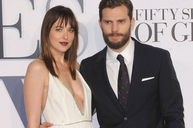 American fashion model and actress Dakota Johnson and Northern Irish actor and model Jamie Dornan attend the UK premiere of Fifty Shades of Grey on February 12, 2015. Photo by Paul Treadway/UPI
