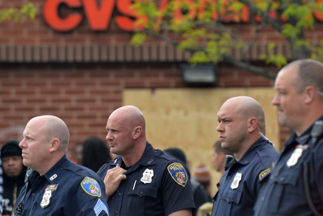 New research suggests the simple act of putting on a police uniform can change the way humans perceive other people. Photo by Kevin Dietsch/UPI