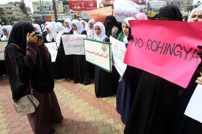 Palestinian students protest Myanmar's oppression towards Rohingya Muslims in Rakhine State, in Rafahu in southern Gaza on September 14, 2017. Photo by Ismael Mohamad/ UPI