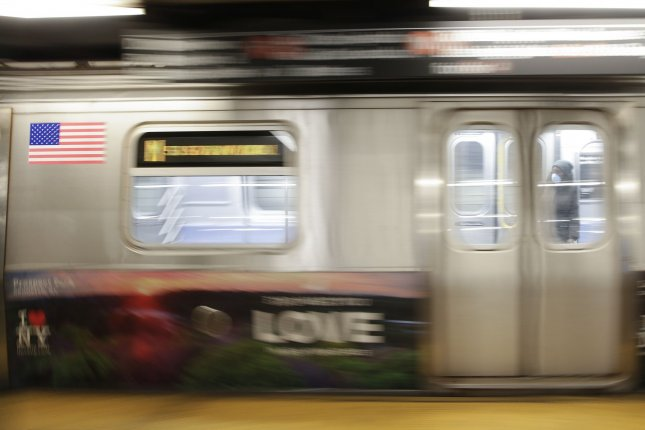 An F train subway car is seen in New York City on April 21. Authorities said Thursday the subway trains and stations will be closed for several hours each morning for disinfecting. Photo by John Angelillo/UPI
